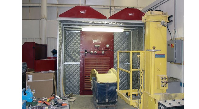 MICRO AIR CAB with regain captures composites dust and particulate in grinding operation.