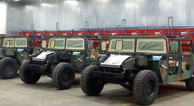 Twelve module CAB system captures sanding and grinding dust at military vehicle refurbish facility.