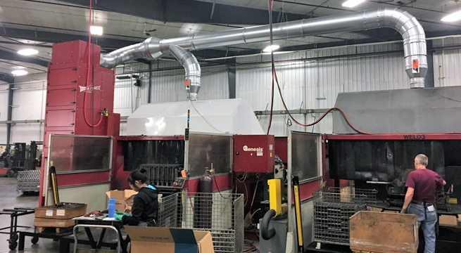 MICRO AIR FRP8 ducted to two large robotic weld hoods.  Each hood is equipped with an electric duct damper that opens only when weld station is in use.