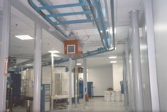 MX3510's installed in a ractrack pattern for ambient collection in a powder coating operation