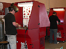 XA23 downdraft tables capture weld smoke and fumes in a weld training center.