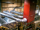 MM2400 ducted to hoods over machining center captures grinding dust and oil mist.