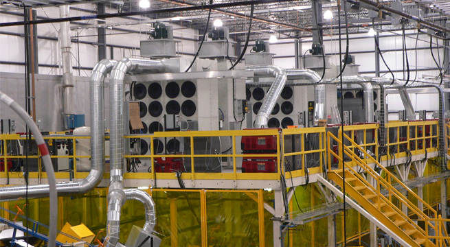 Large Tier 1 automotive supplier with 120 robotic welders is kept clean, and free of hazardous weld smoke and fumes utilizing 22 each RP8-2, 16 cartridge collectors, installed on mezzanine over robotic weld cells.