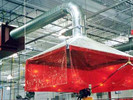 Micro Air MC3000 ducted to hood over weld cell eliminates smoke in work area.