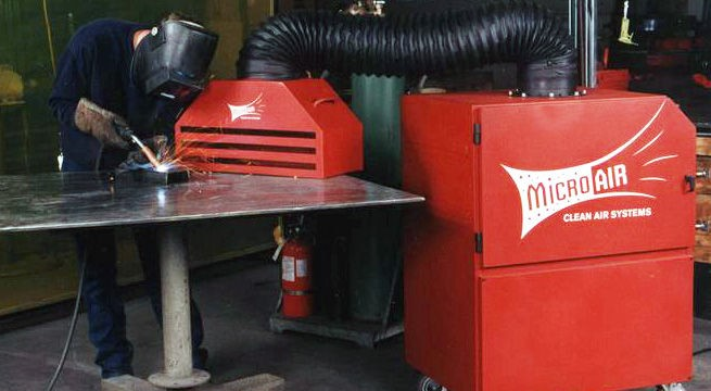 Micro Air TM1000 equipped with backdraft hood removes smoke and fumes from the work area.